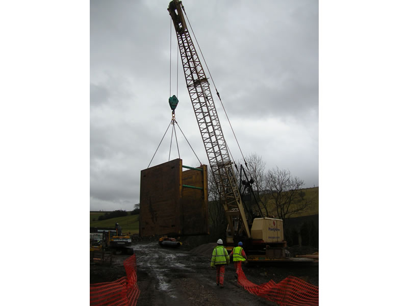 Large trench boxes handled by crane
